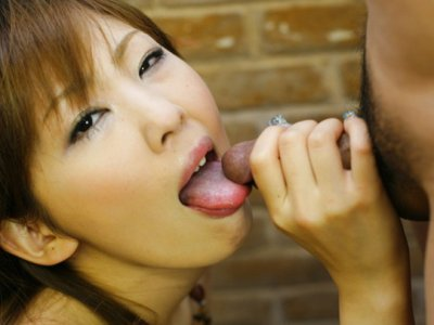 Delicate Oriental beauty jacks off two dicks