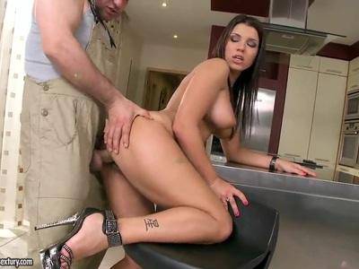 Busty brunette Angel Rivas gives head to her handyman