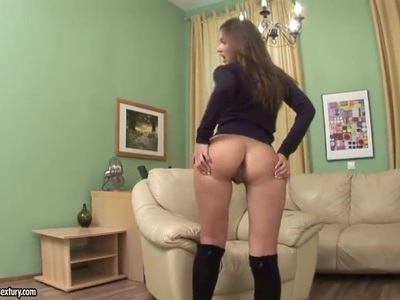 Ava demonstrates her perfect ass and plays with a dildo