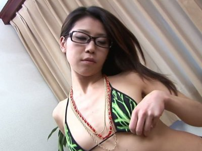 Brunette slut Mizuki Ogawa gives a blowjob and licks him all over the body