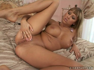 Alexandra Diamond palms her breasts and exposes her palatable ass