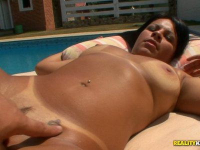 Chubby black haired hoe gets her fat cunt eaten over the pool