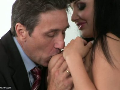 Lascivious brunette Aletta Ocean blows cock of an office worker