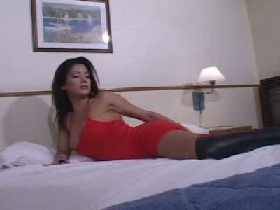 Lustful shemale skank Claudia masturbates on a couch toy fucking her asshole