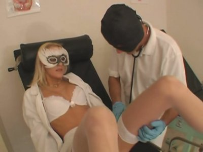 Blond babe squirts on gynecological chair