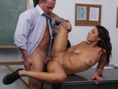 Young brunette Gigi Loren gets her pussy drilled on the table