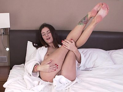 Teen fills her asshole with a fat dildo